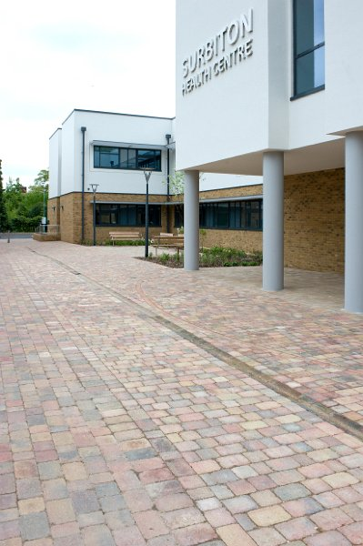 BRETT LANDSCAPING PAVING DESIGN UNITES MEDICAL CENTRE AND SCHOOL