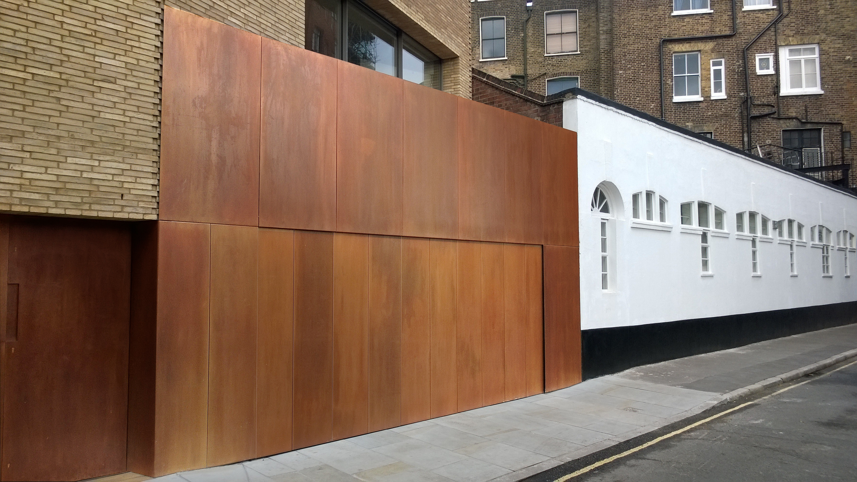 Patinated Brass Side Sectional Door By Rundum Meir
