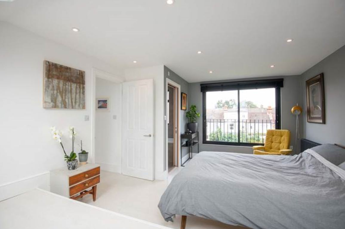 The spacious loft conversion is now used as the master bedroom