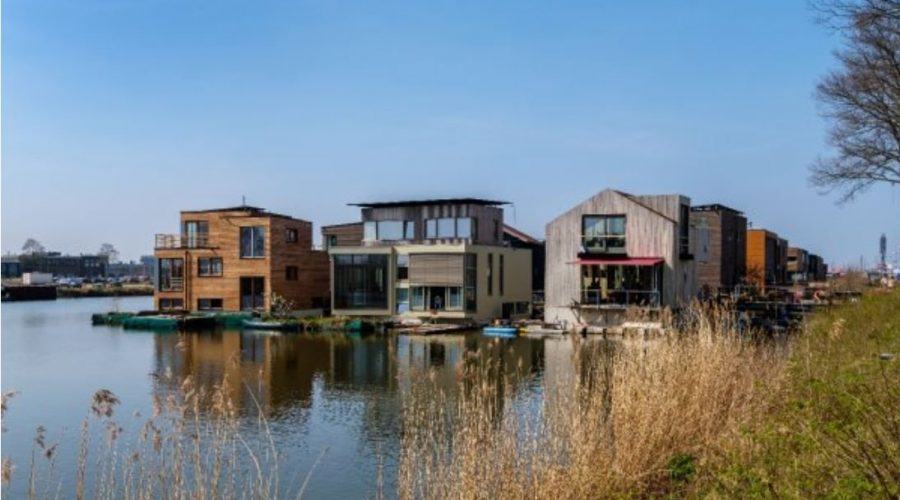 Amsterdam, April 2020. Schoonschip Neighborhood with wooden houses, floating on the water
